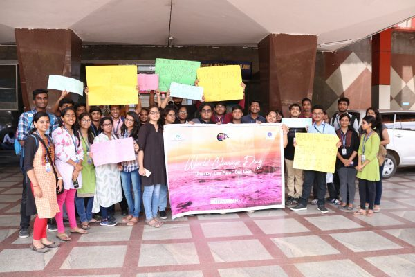 people holding the poster of world cleanup day
