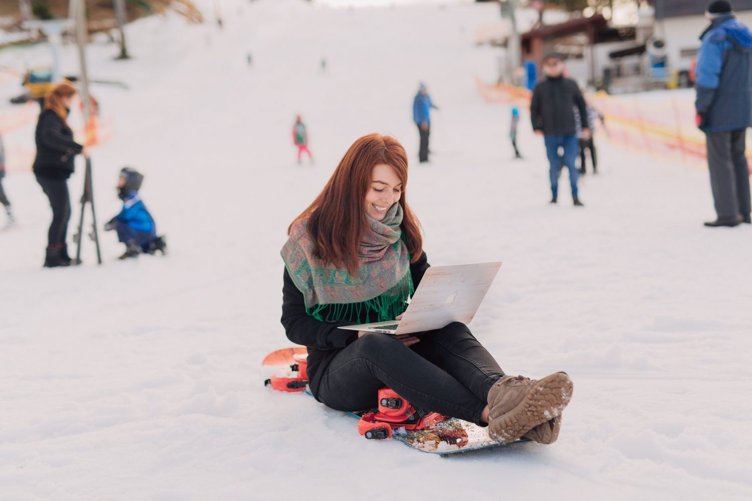 girl in a snowboard using the laptop
